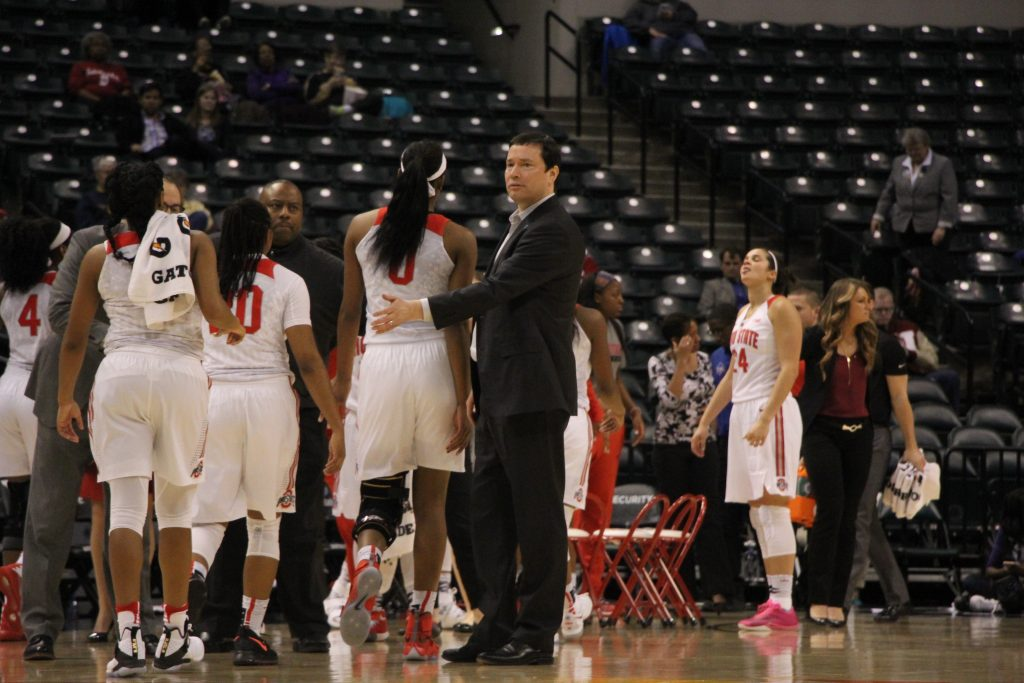 OSU coach Kevin McGuff pats freshman forward Tori McCoy on the back as the team heads to the sideline during a timeout in Big Ten tournament against Northwestern on March 3. Credit: Ashley Nelson | Sports Director