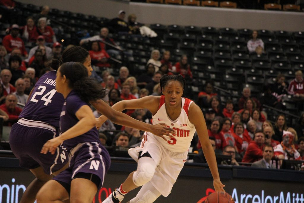 OSU junior guard Kelsey Mitchell dribbles around senior guard Christen Inman of Northwestern on March 3 during the Big Ten tournament in Bankers Life Fieldhouse in Indianapolis. OSU won, 99-68. Credit: Ashley Nelson   Sports Director