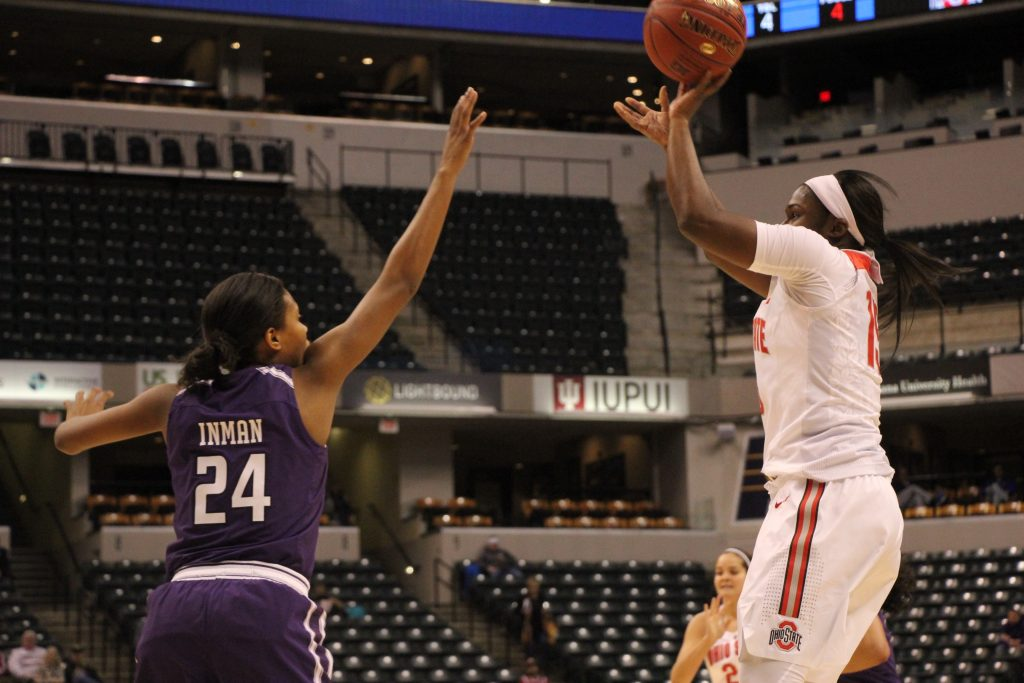 OSU junior guard Linae Harper puts up a shot over Northwestern senior guard Christen Inman on March 3 in Indianapolis. OSU won, 99-68, in Bankers Life Fieldhouse.