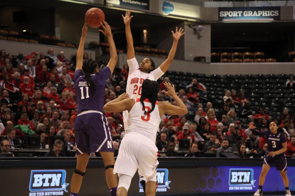 OSU junior guard Asia Doss blocks a shot in the Big Ten tournament against Northwestern on March 3. Credit: Ashley Nelson   Sports Director