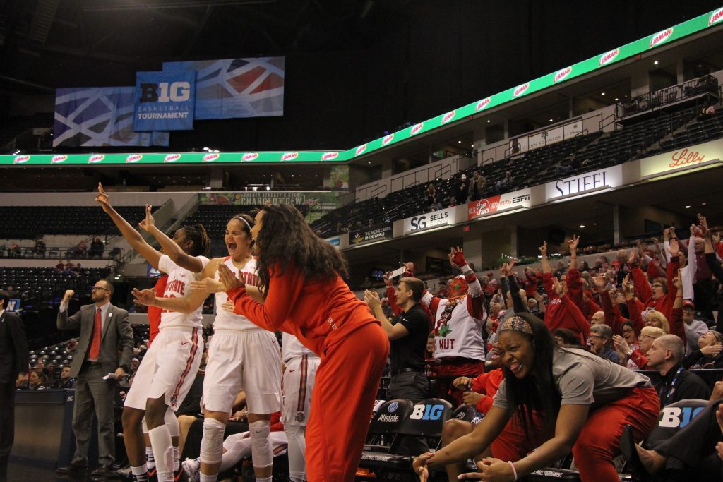 OSU junior forward Alexa Hart (22) and redshirt junior guard Kianna Holland (right) celebrate the team's win on March 3 at the Bankers Life Fieldhouse in Indianapolis. Credit: Ashley Nelson | Sports Director