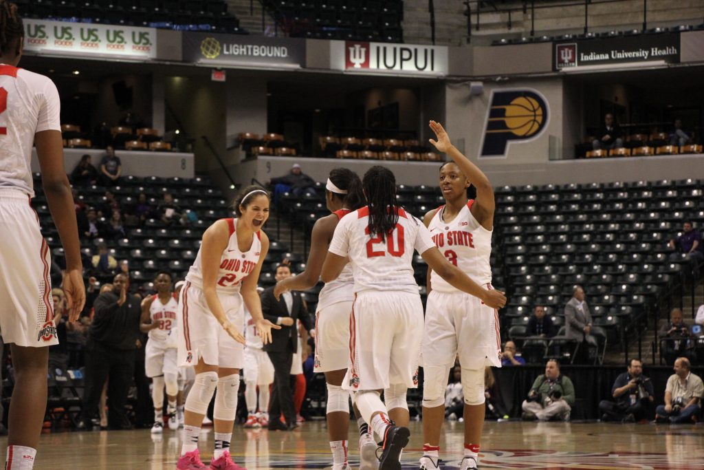 OSU junior guard Asia Doss is congratulated by teammates while returning to the bench during the Buckeyes 99-68 victory over Northwestern on March 3. Credit: Ashley Nelson | Sports Director