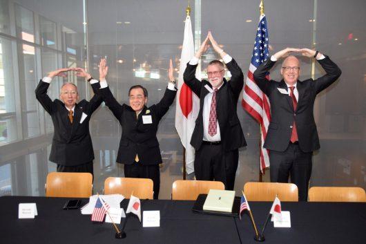 Shuzaburo Takeda, Seiichi Matsuo, Bruce McPheron, and David Manderscheid signing ceremony of the agreement at Thomson Library, March 9. Credit: courtesy of Victor van Buchem