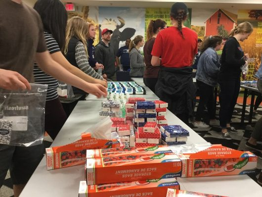 Students move through an assembly line as they prepare care kits for the homeless. Credit: Erin Gottsacker | Lantern reporter