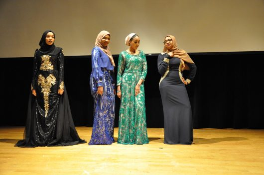 A group of models pause to showcase their dresses, which are mix of modern and traditional Somali style, during the fashion show at the first annual Somali Student Association National Conference on March 31. Credit: Hailey Stangebye | Lantern reporter