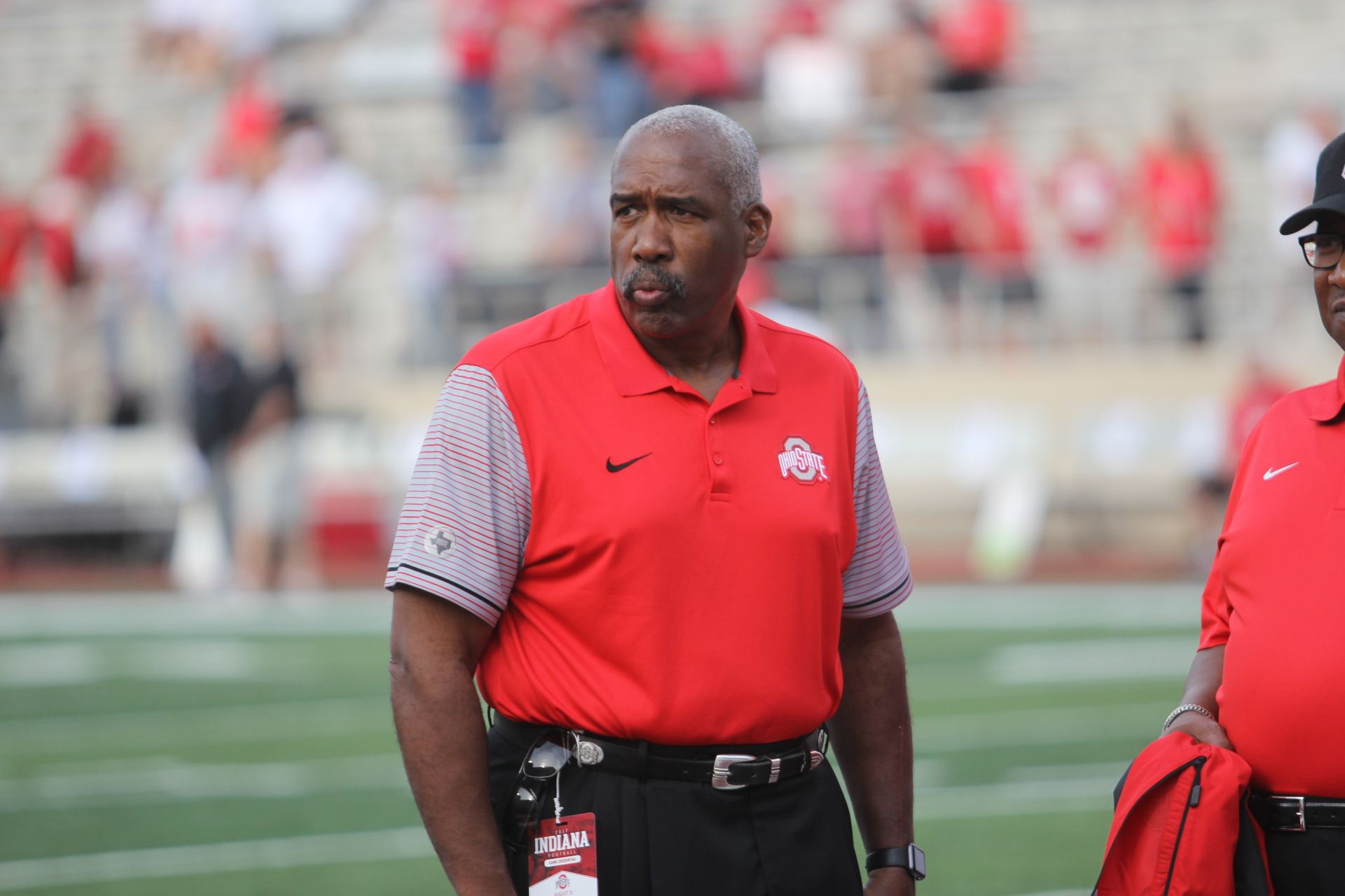 Gene Smith walks on the field at Ohio Stadium before a game
