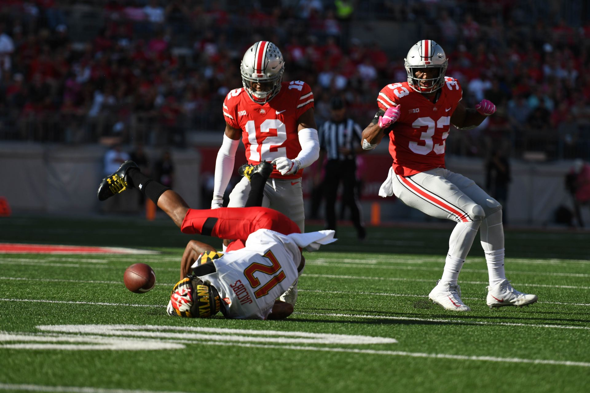 Junior corner back Denzel Ward (12) tackles Taivon Jacobs of Maryland  during the Ohio State game on Oct. 7 at Ohio Stadium. Ward was ejected  immediately ... f5b8cabda