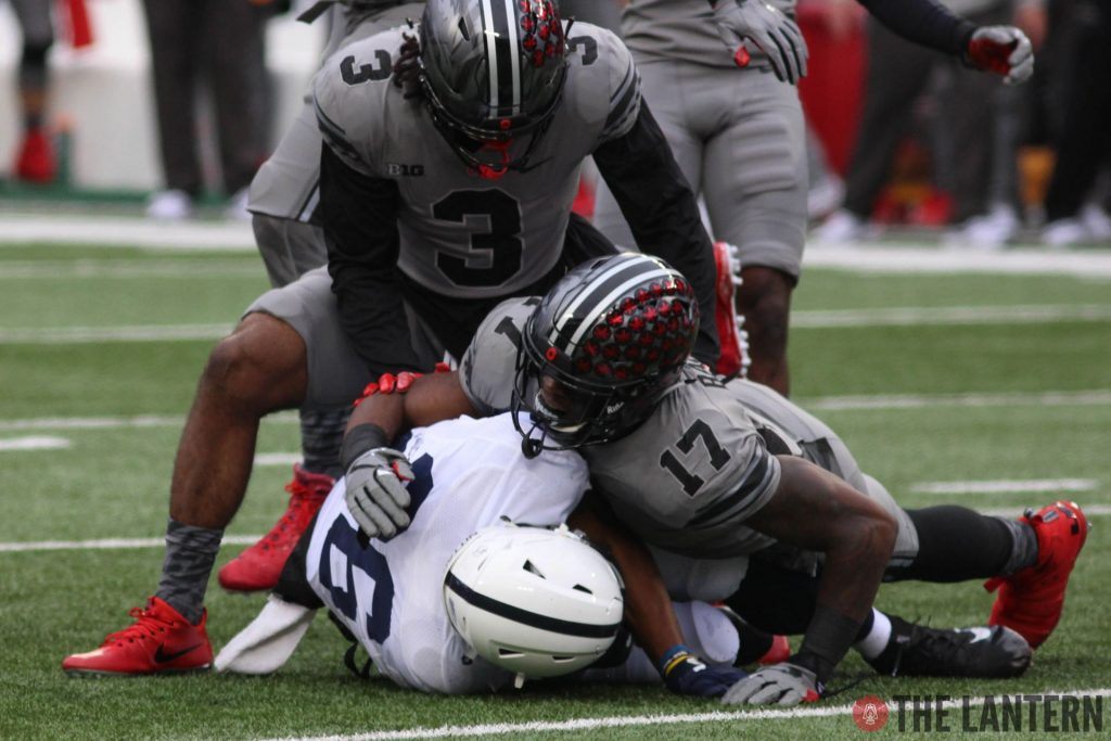 99fb8adb1 Ohio State junior linebacker Jerome Baker (17) combines for a tackle with  redshirt sophomore cornerback Damon Arnette (3) on Penn State s Saquon  Barkley in ...