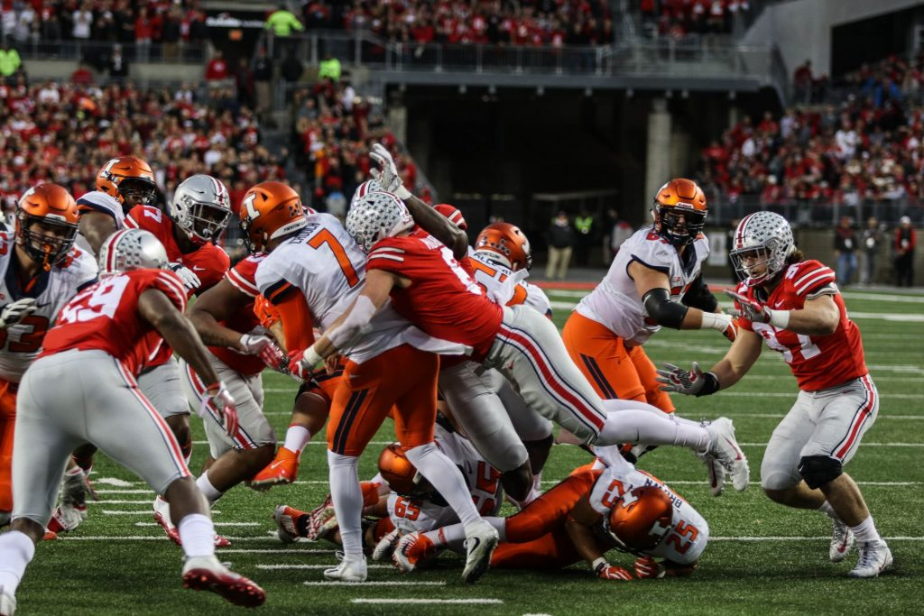 Ohio State football players tackle Illinois players