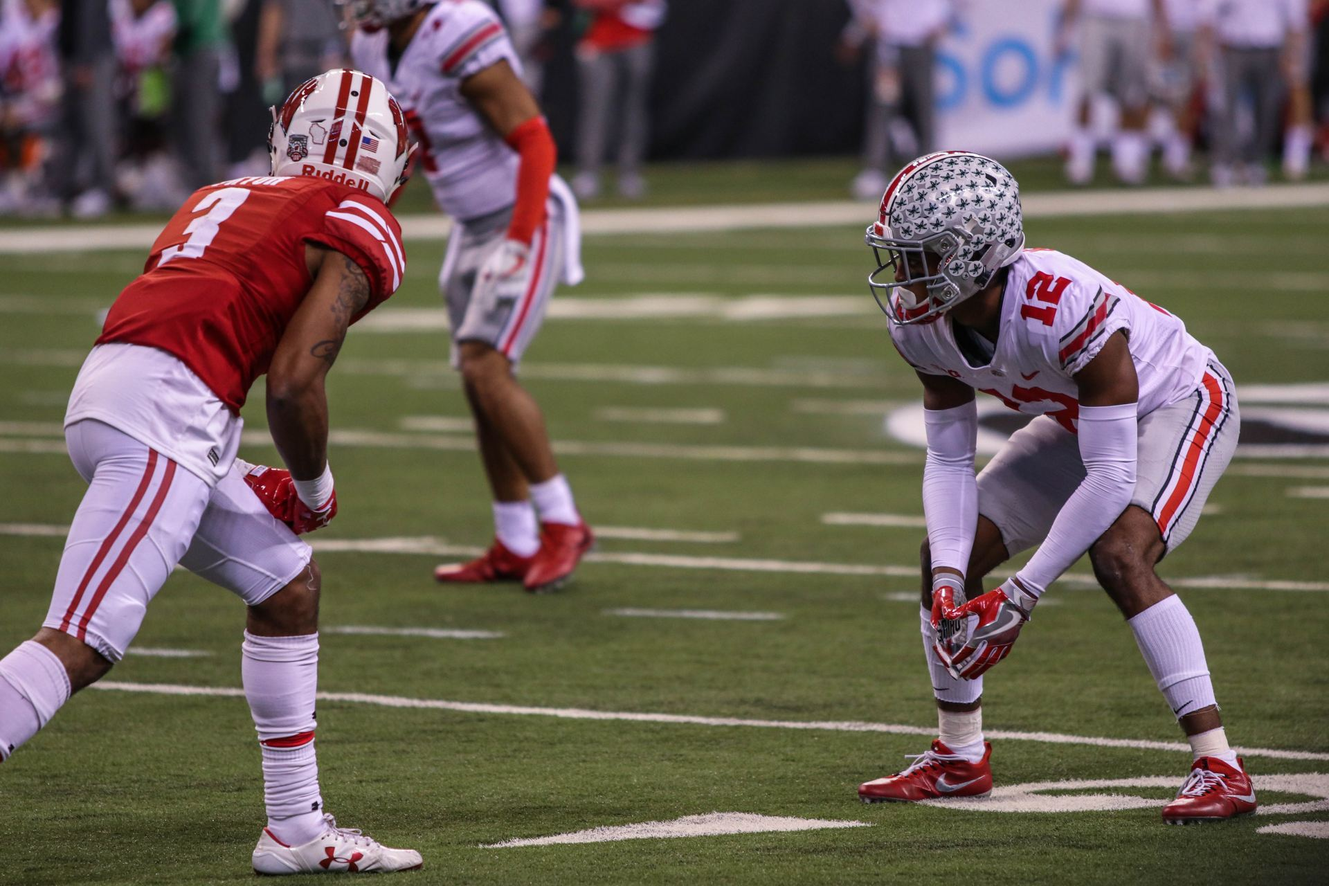 Ohio State junior cornerback Denzel Ward (12) sets up prior to a play in  the second quarter of the B1G Championship game against Wisconsin on Dec. 6a540bce2