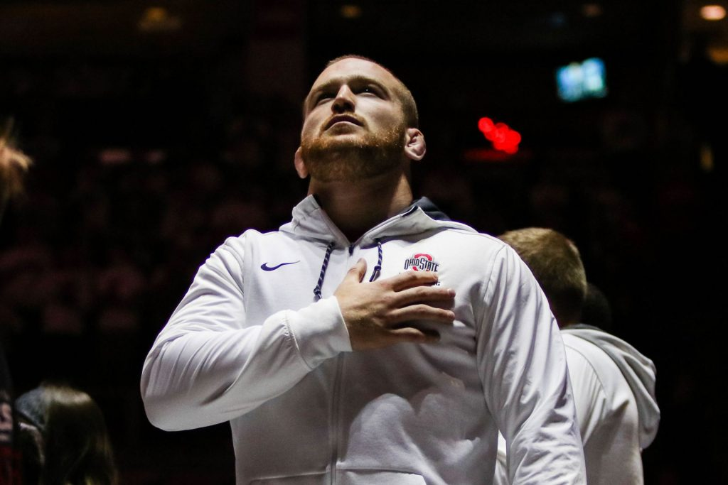 Ohio State's Kyle Snyder stands during the national anthem prior to the the dual-meet against Iowa on Jan. 21 in the Schottenstein Center. Credit: Jack Westerheide | Photo Editor