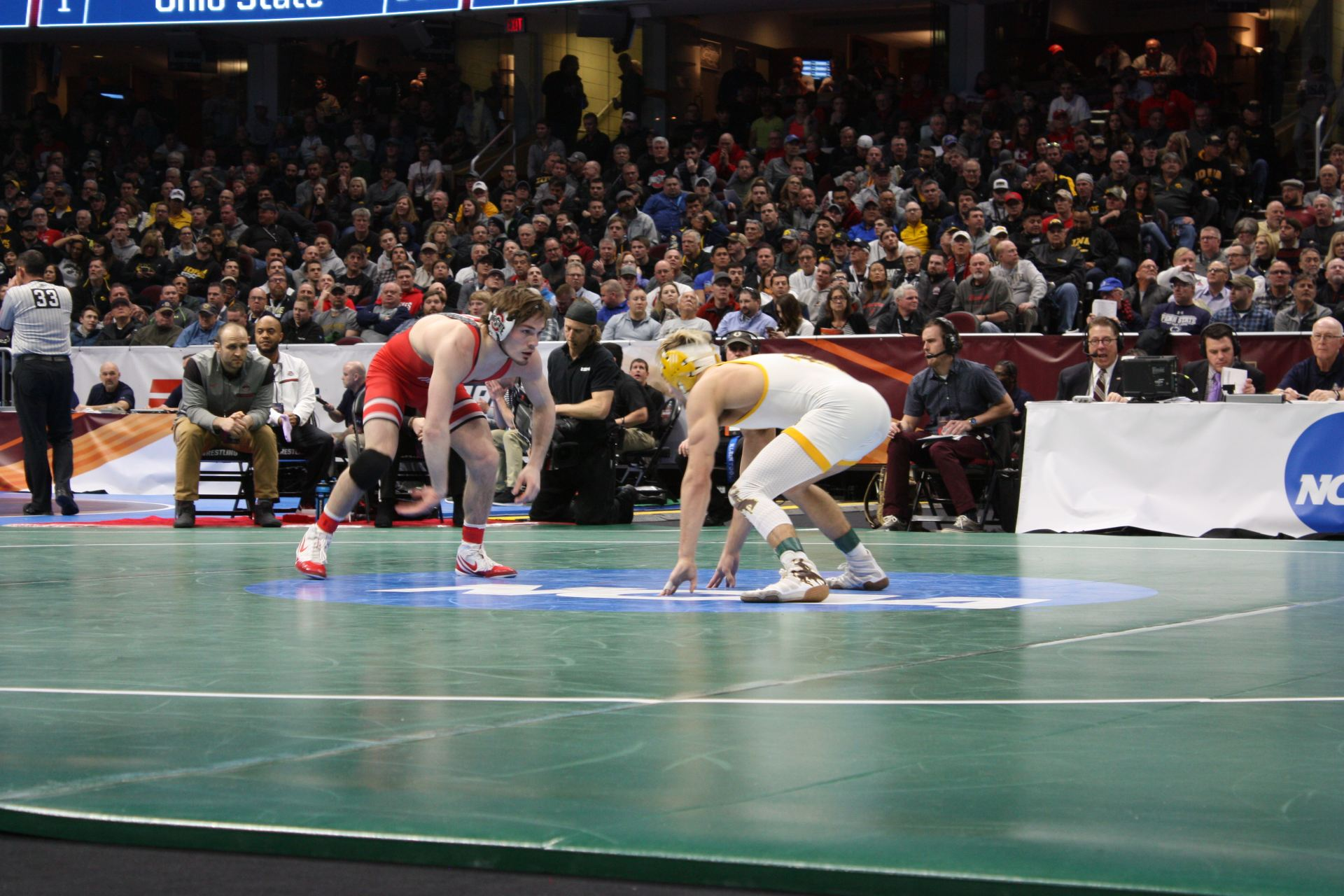 super popular 18351 56409 Ohio State junior Joey McKenna faces off with Wyoming s Bryce Meredith on  Friday, March 16, 2018 at the Quicken Loans Arena in Cleveland at the NCAA  ...