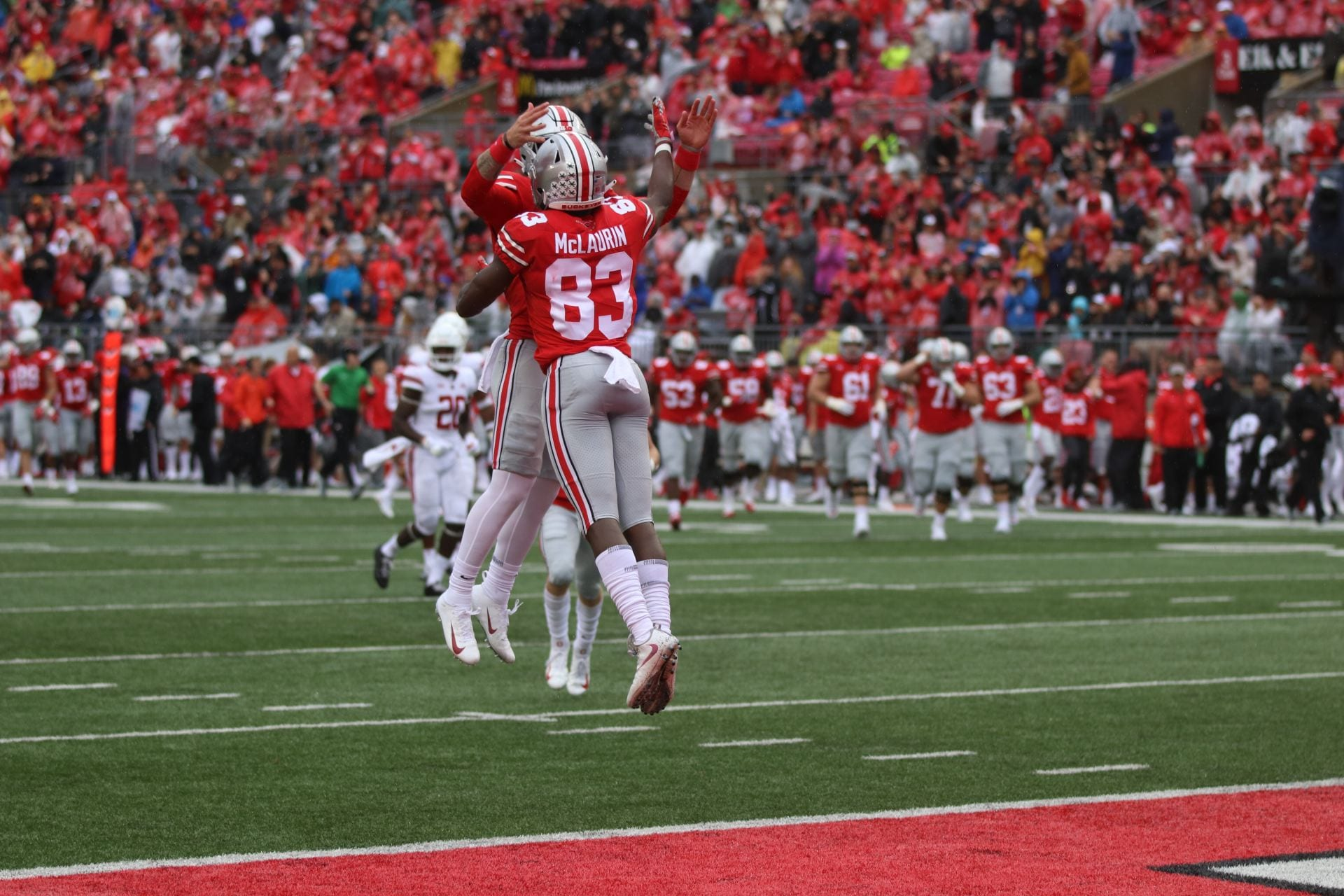 Ohio State redshirt senior wide receiver Terry McLaurin (83) and redshirt  freshman quarterback Tate Martell (18) celebrate after a touchdown in the  second ... 703f1a53d