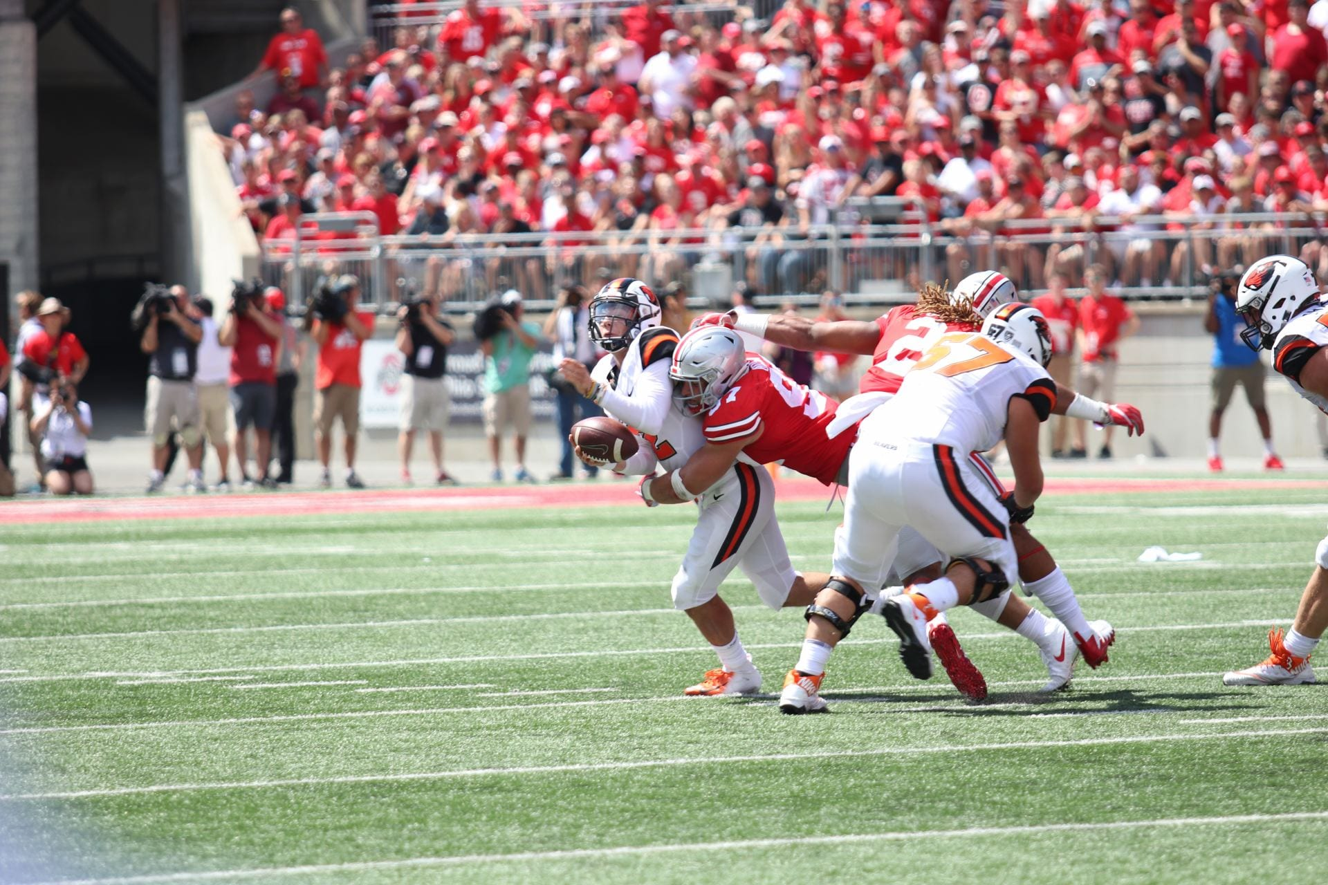 ee133a160ec Junior defensive end Nick Bosa sacks redshirt sophomore quarterback Conor  Blount in the game between Ohio State and Oregon State on Sept. 1.