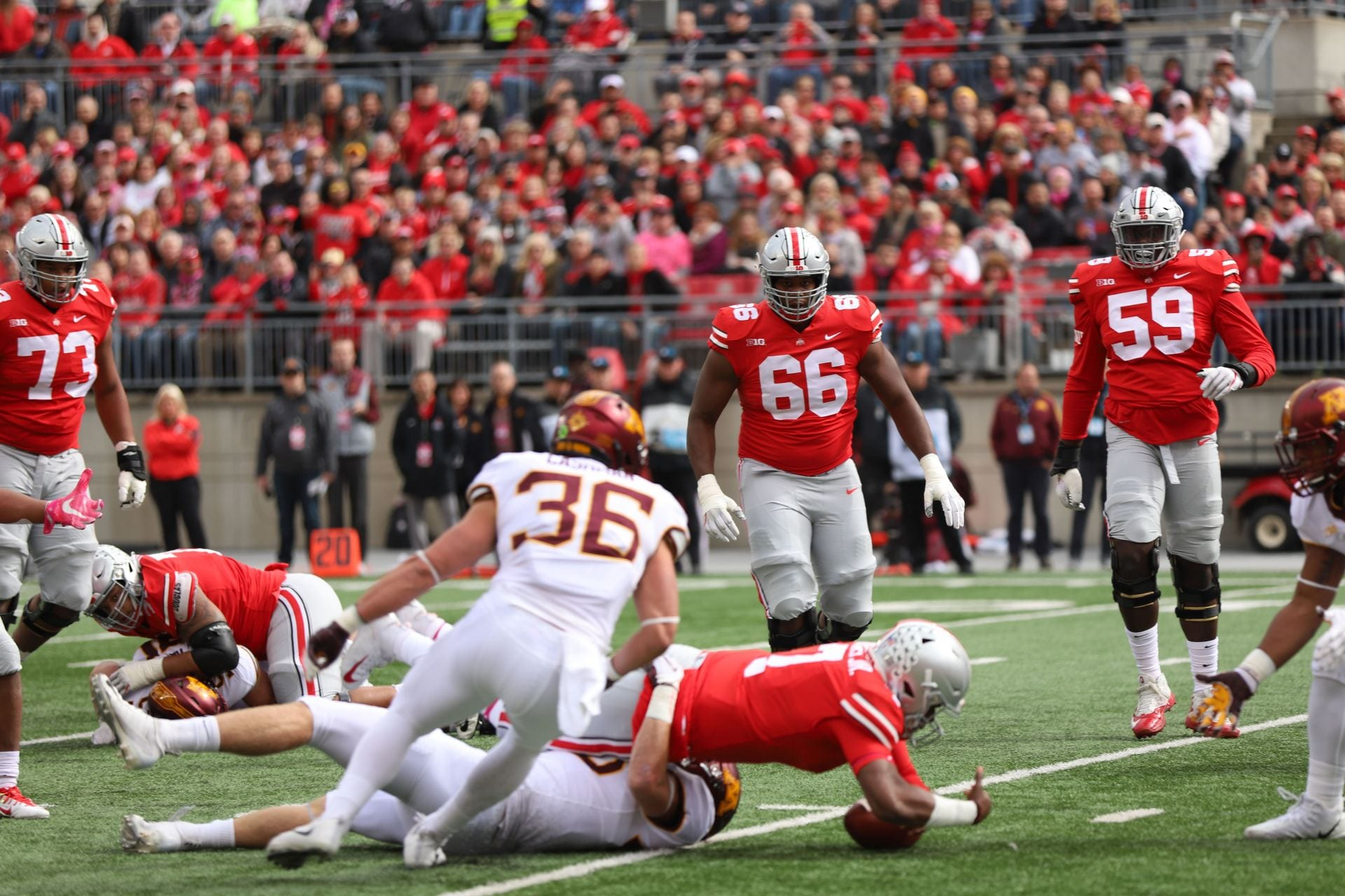 best sneakers 001b7 f3b20 Ohio State redshirt sophomore quarterback Dwayne Haskins (7) gets tackled  after a run during the first quarter of the game against Minnesota on Oct.  13.