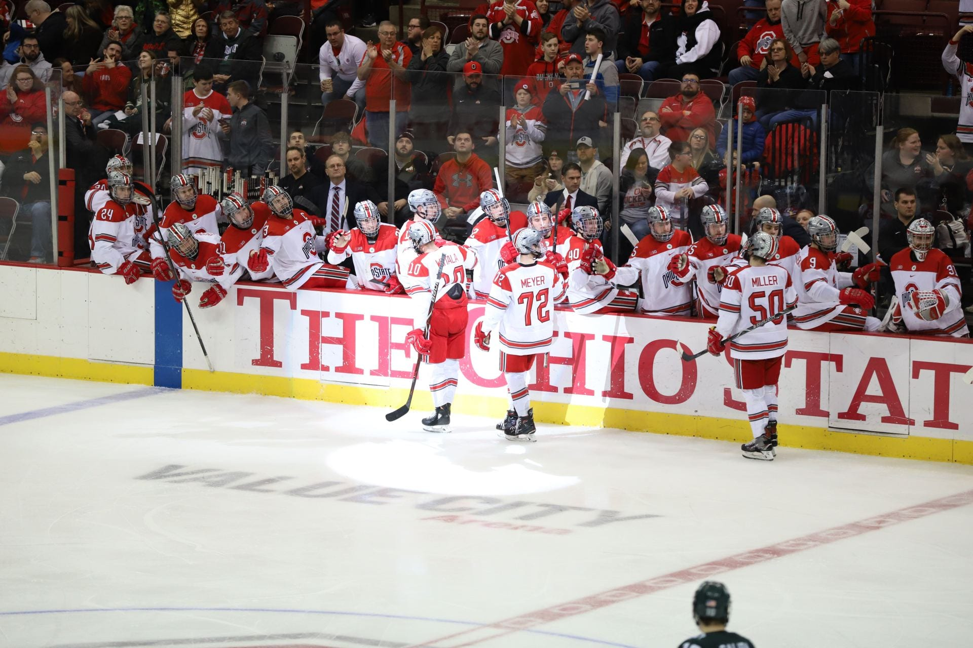 Ohio State hockey players celebrate a goal.
