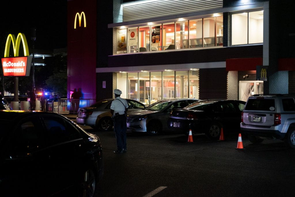 Police cordoned off the McDonald's parking lot. Police were seen shining flashlights into the parked cars. Credit: Jack Long | Special Projects Director