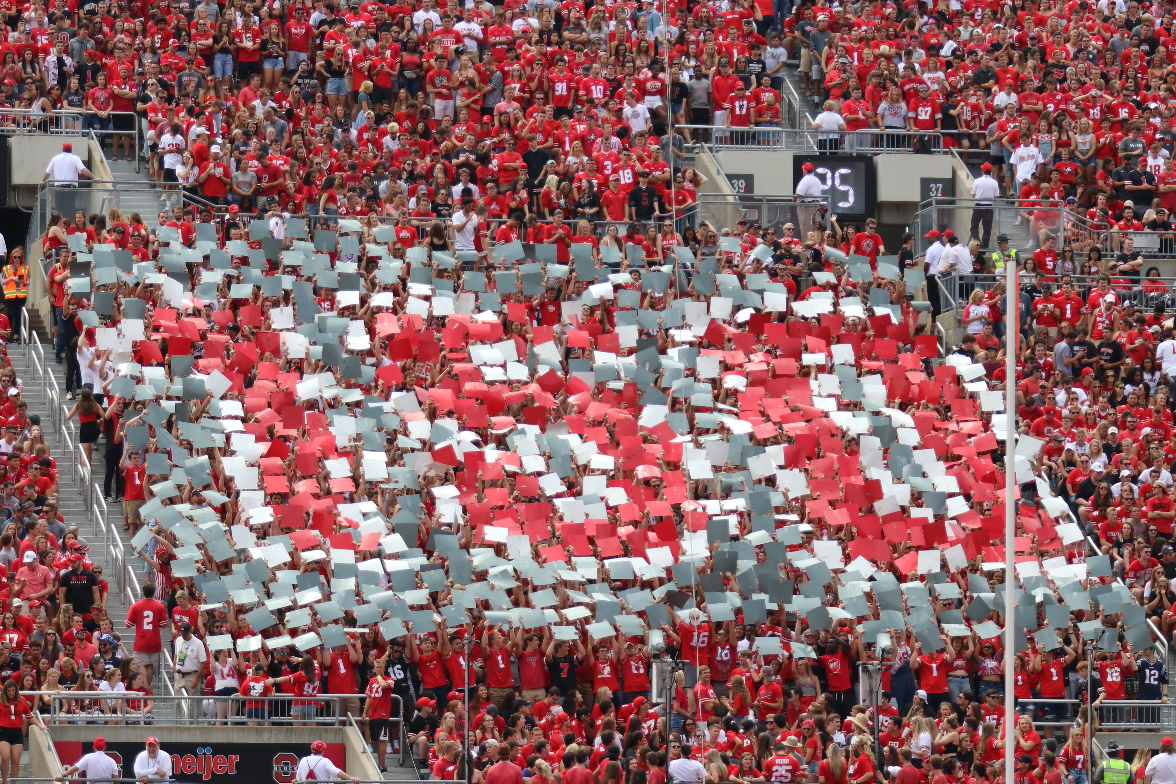 "Students in Block O hold up posters to spell ""150"" in honor of Ohio State's sesquicentennial in the first half of the game against Cincinnati"