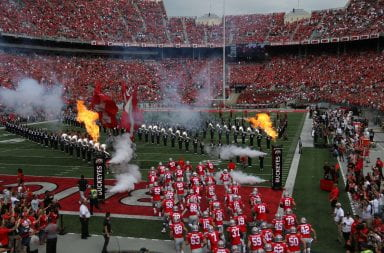 The Buckeyes take to the field prior to the start of the game against Cincinnati in front of an Ohio Stadium filled with fans.
