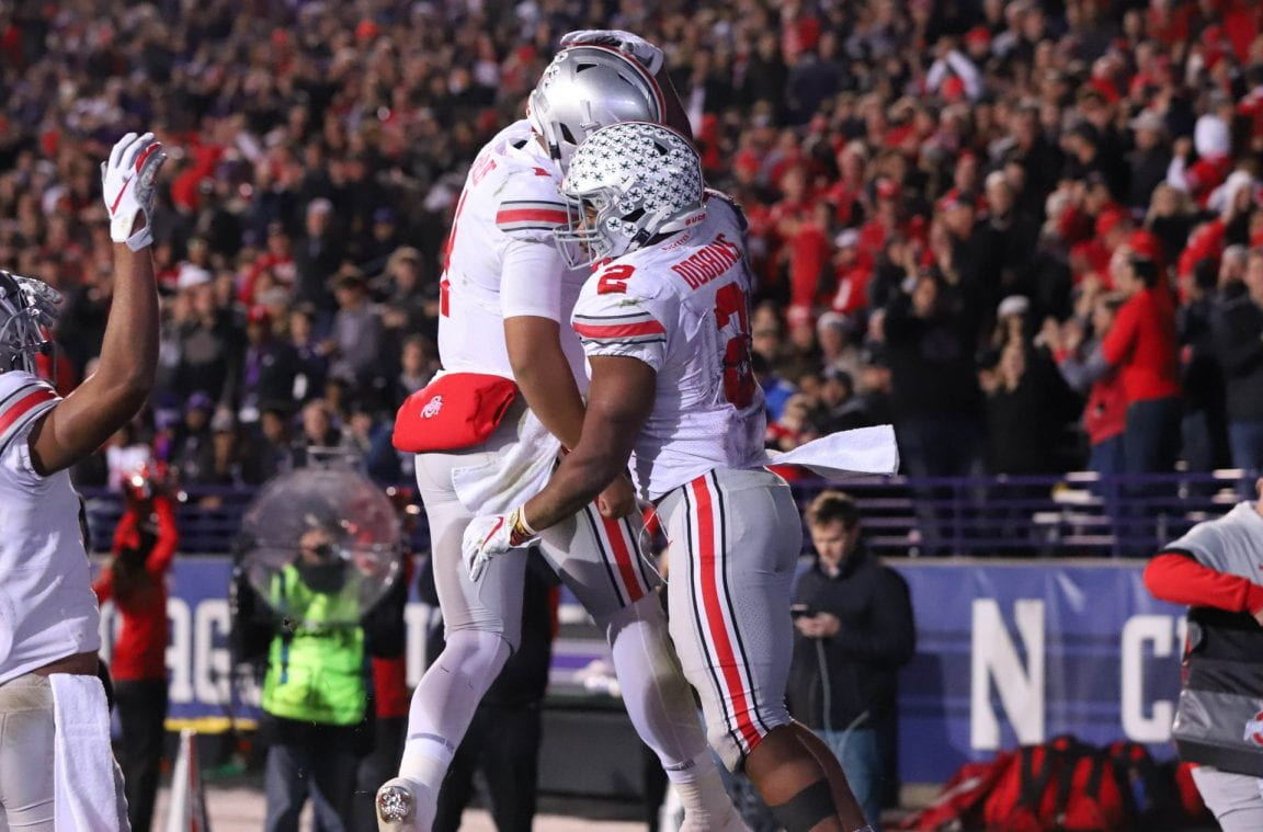 Football: Dobbins turns slow start into slaughter against Northwestern