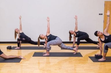 Ohio State fitness instructors practice yoga in Aug. 2018 at the RPAC. Credit: Courtesy of Ohio State Office of Student Life