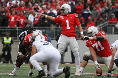 Justin Fields points at someone on the defense