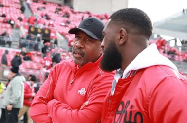 Athletic director Gene Smith talks to a former football player inside Ohio Stadium