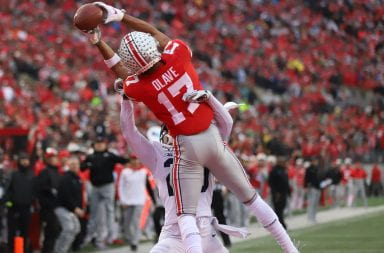 Ohio State wide receiver Chris Olave catches a pass over a Penn State defender