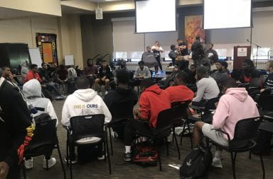 Students receive lineups by barbers while breakout discussion is facilitated on the floor at the fall 2019 Barber Shop Talks in the MLK Lounge of Hale Hall. Credit: Andre'as Williams | For The Lantern