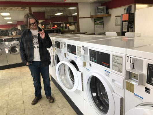 Drew Sherrick owner of Dirty Dungarees, explains that this is the last laundromat-pub still open in Columbus. Darby Clark | Lantern Reporter