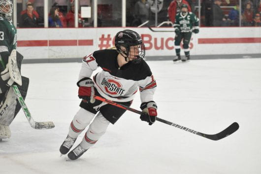 Ohio State junior forward Emma Maltais (17) zones in on the movement of the puck during the Ohio State-Bemidji State game on Jan.31. Ohio State won 7-2. Credit: Mackenzie Shanklin | For the Lantern