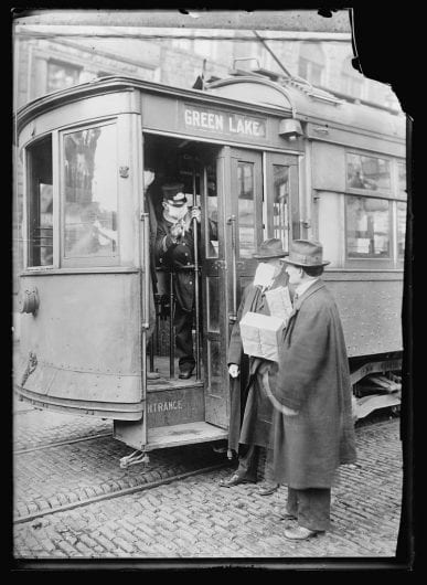 During the 1918 influenza outbreak, street car passengers in Seattle, Washington were required to wear face masks. Credit: The Library of Congress