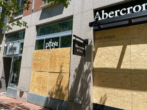 Clothing store Pitaya was boarded up after its storefront was damaged Saturday.