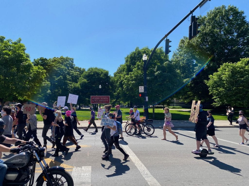 Demonstrators move south down North High Street, passing south campus.