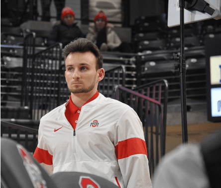 Drew Moling, director of operations for men's and women's gymnastics, at the Feb. 29 meet against Navy at the Covelli Center. Credit: Alyssa Jacobs | For the Lantern