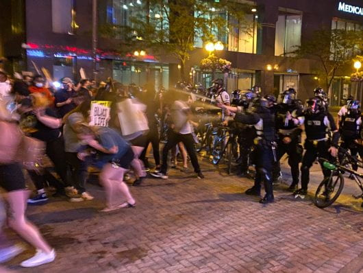 Columbus Police pepper-sprayed protesters Thursday night after a Lime scooter was thrown at police. Credit: Max Garrison | Asst. Campus Editor
