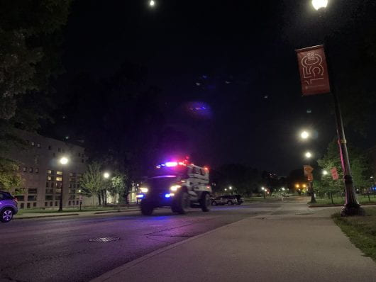 An armored University Police vehicle drives east on West 12th Avenue. Credit: Jack Long | Managing Editor for Digital Content