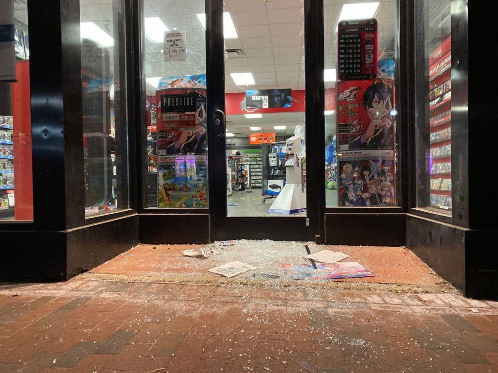 The glass door of GameStop on High Street was broken Saturday night. Credit: Max Garrison | Asst. Campus Editor