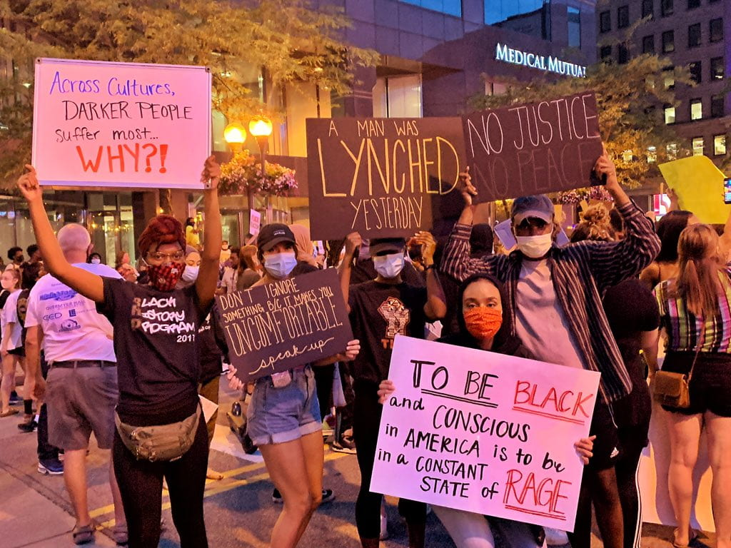 Students from Ohio State and Miami University protested Thursday night on High Street. | Courtesy of Winnie Labissiere