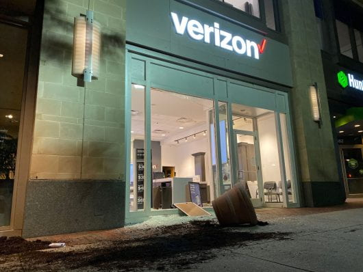 An overturned potted plant lays outside the shattered Verizon storefront. Credit: Max Garrison | Asst. Campus Editor