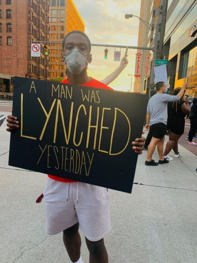 Alex Ushry, a third-year in finance, holds up a sign at the protests for the death of George Floyd in downtown Columbus on May 28. | Courtesy of Kaelyn Sanders