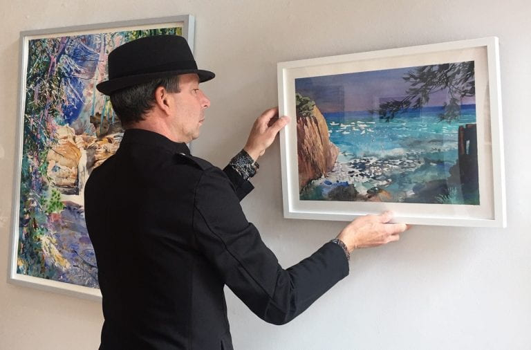 "Michael Kaiser hangs ""View,"" his exhibition opening at the Sherrie Gallery during the Virtual Gallery Hop May 2. Credit: Courtesy of Sherrie Hawk"