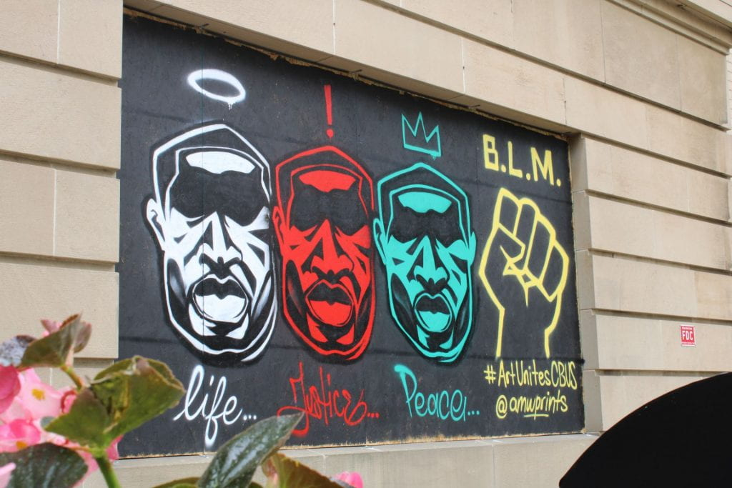 Murals have been painted on the plywood covering windows and doors of businesses in Columbus, Ohio. Credit: André White | Arts & Life Producer