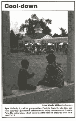 Newspaper clipping from June 20, 1994 of boy and grandmother sitting on bench at Juneteenth celebration