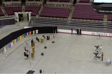 The speakers for the 2020 summer virtual commencement stand at podiums spaced out throughout the Schottenstein Center as the ceremony is live streamed.