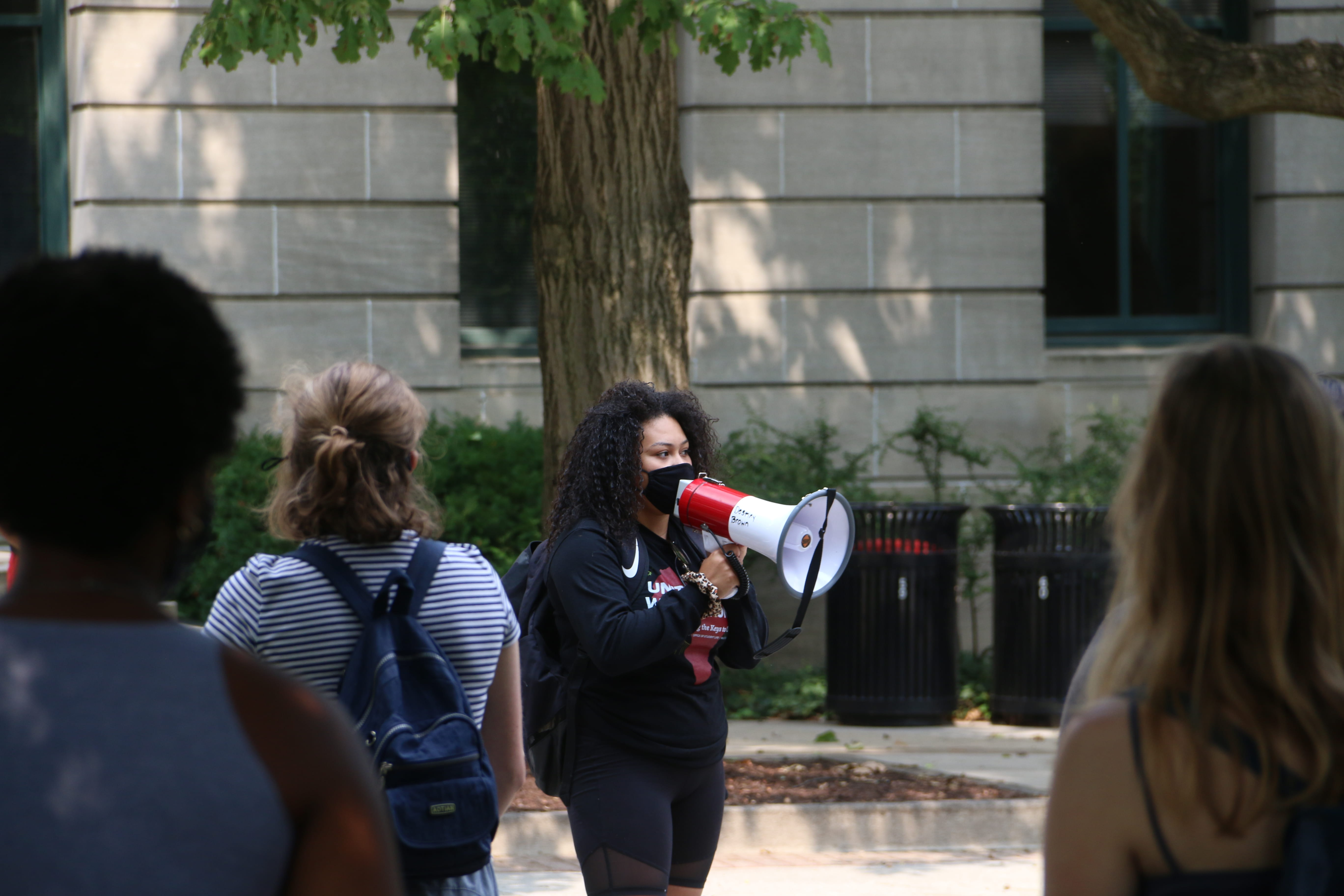 Destiny Brown, a fourth-year in political science, addresses the demonstration outside Bricker Hall