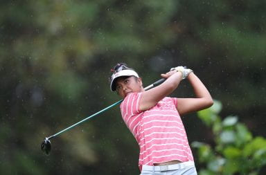 Aneka Seumanutafa swinging a golf club