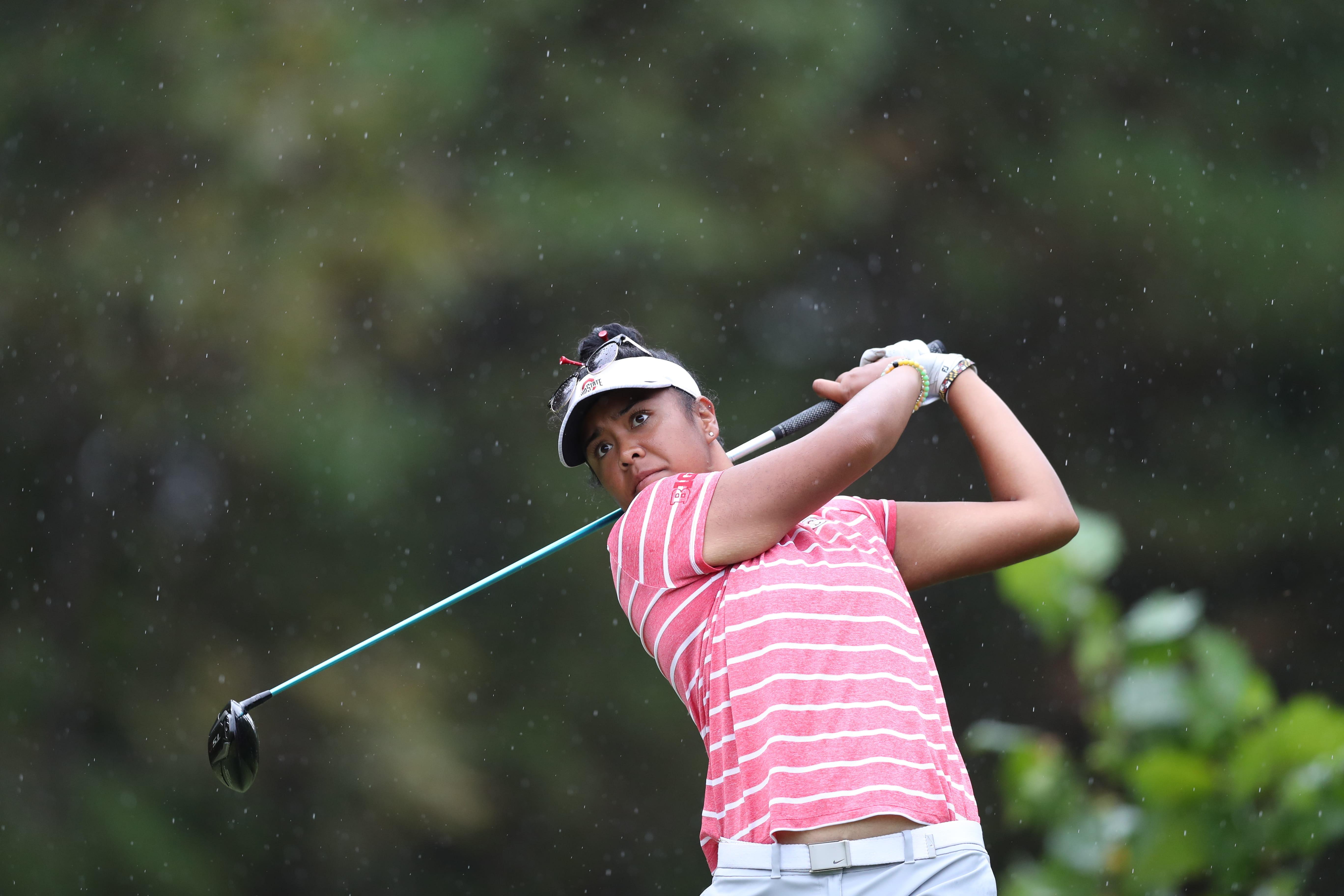 Aneka Seumanutafa swinging a golf club