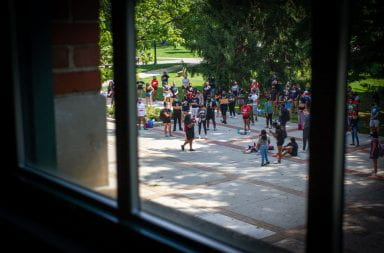 Students gather outside Bricker Hall