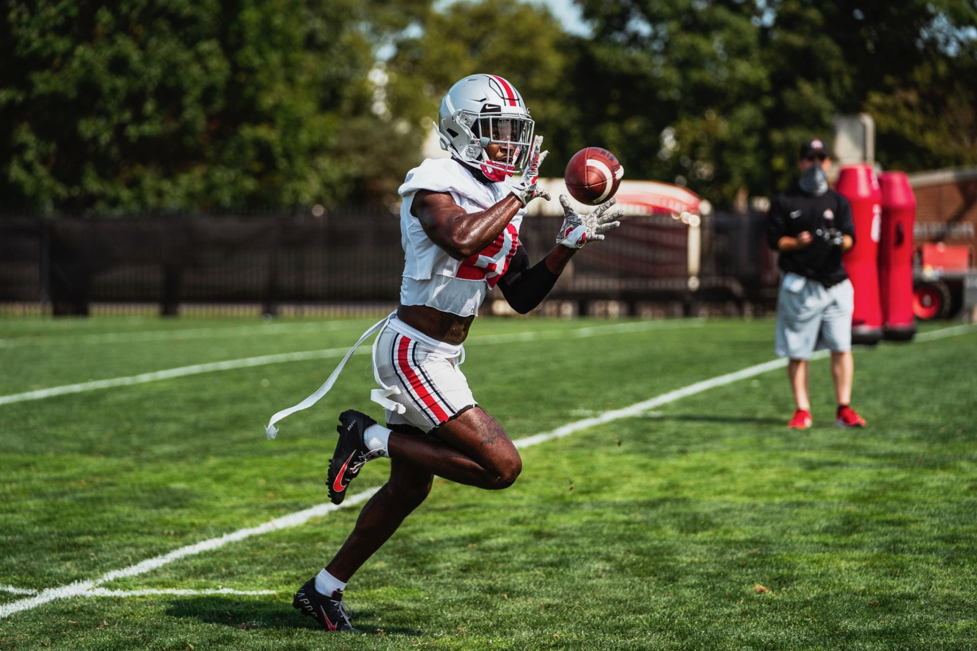 Marcus Williamson catching a pass in practice while running a drill.